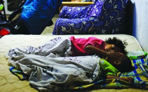 Israeli family sleeps in a bomb shelter, after a rocket launched by Palestinian militants from Gaza strip hits the southern Israeli town of Ashkelon.