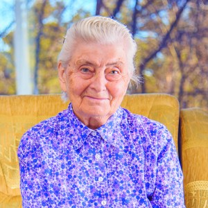 Grandma sitting in a yellow chair -378685924