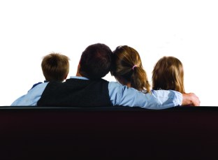 A family of four watching a blank screen