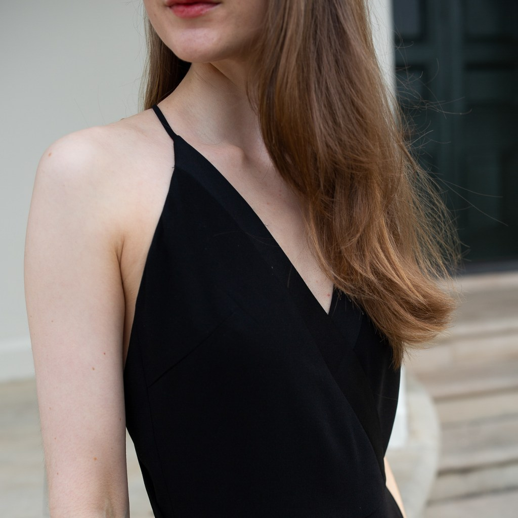 A girl wearing a black halter neck black jumpsuit from Zara and neutral heels standing in front of Tempe House Sydney. Formal dresses, event wear, black jumpsuits, quality over quantity, conscious consumer, fewer better, buy well, minimalist wardrobe principles
