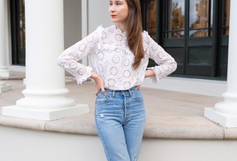 How to create an outfit inspired by Pinterest. Girl standing in front of a historical building in Sydney wearing a thrifted white lace vintage inspired top with ruffle detailing around the neckline and sleeves. She is also wearing and Levis