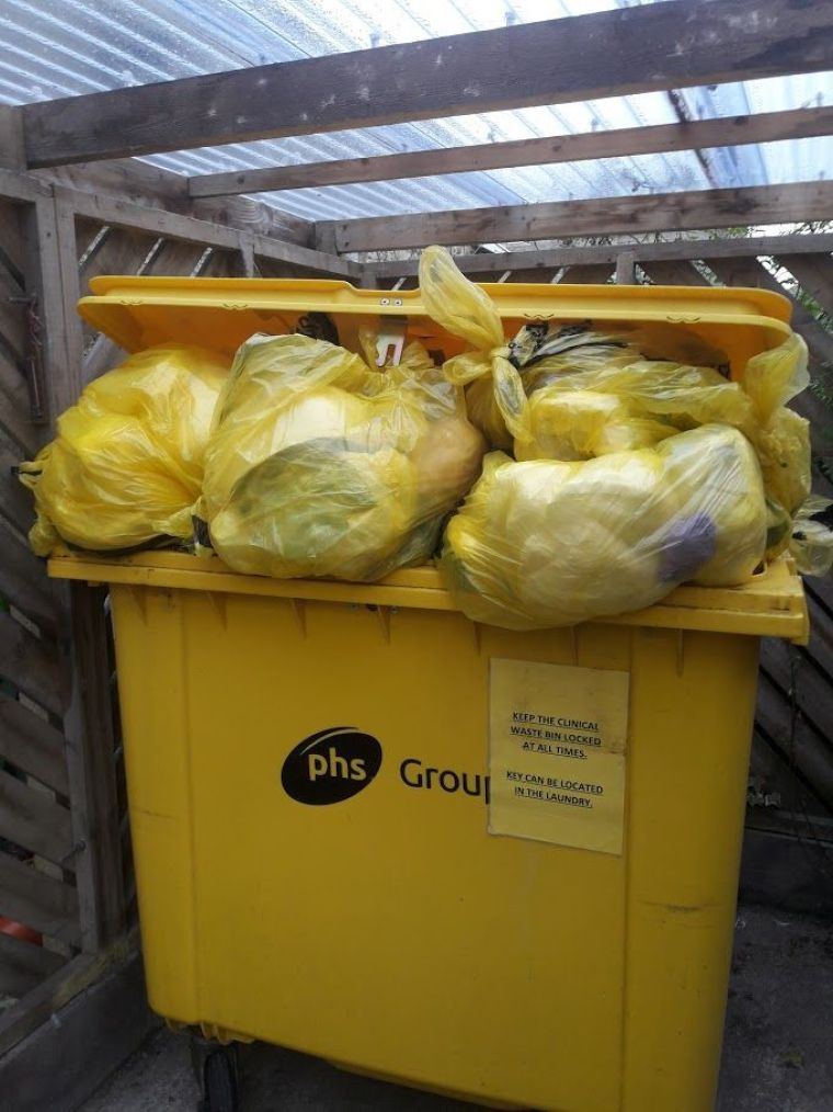 OVERFLOWING: The clinical waste bin at Harbour House care home is yet to be emptied after more than two weeks, with staff frantically trying to resolve the situation