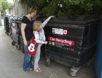 small image of a girl using the recycling point bins