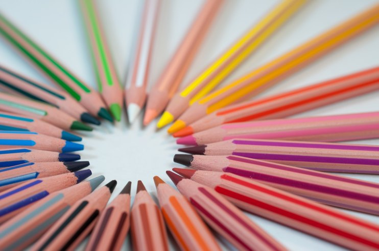 Circle of rainbow colored pencils