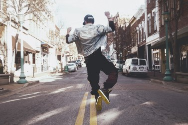 Young man dancing in the street