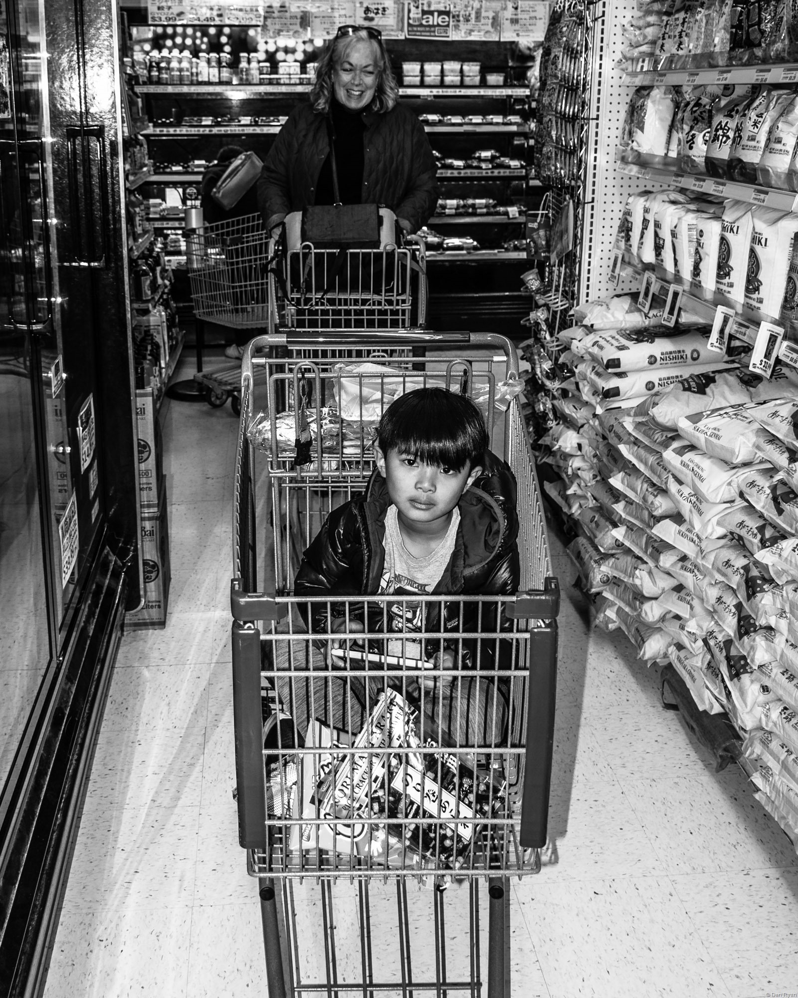 kid in shopping cart at Nijiya Market