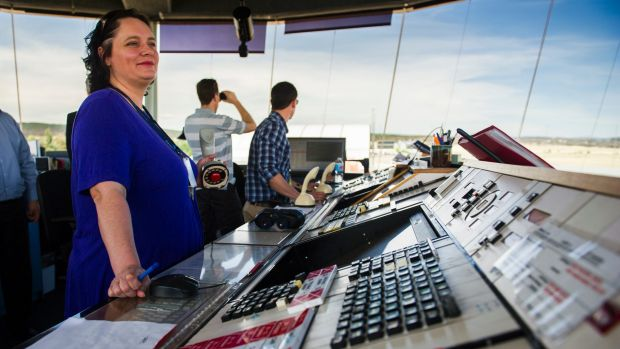 On watch: An officer keeps watch at the Canberra Airport control tower last month.