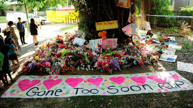 A  memorial of flowers, toys and candles in a park next to the home where the multiple stabbing occurred in Cairns.