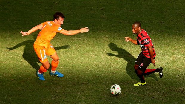 Shadow boxing:  Romeo Castelen of the Wanderers controls the ball in the Brisbane sun.
