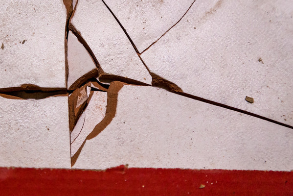 Close up shot of some broken tile in a red box.