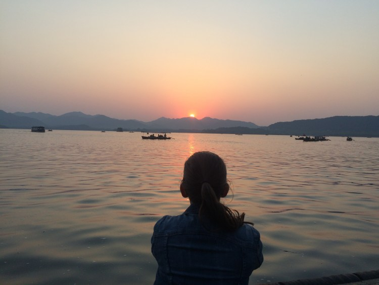 The sun sets over The West Lake