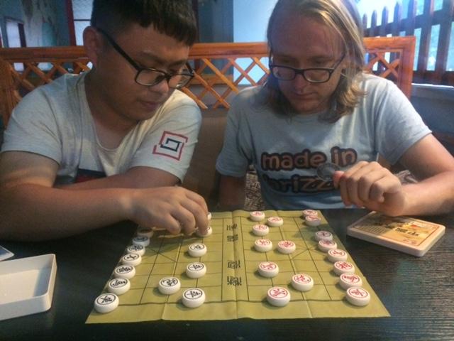 Edmund teaching us Chinese chess.