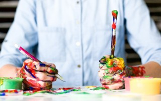 Child with paintbrushes