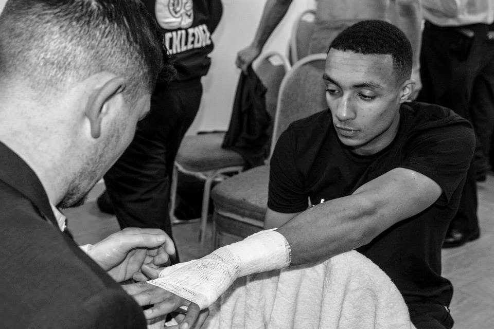 Zelfa Barrett hands wrapped off Michael Jennings