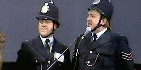 Smith and jones dressed as policeman at live aid in 1985