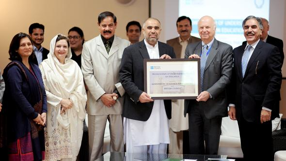 Government of Khyber Pakhtunkhwa, Pakistan and British Council members hold up signed Memorandum of Understanding on education