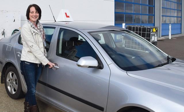 emily howlett outside her car