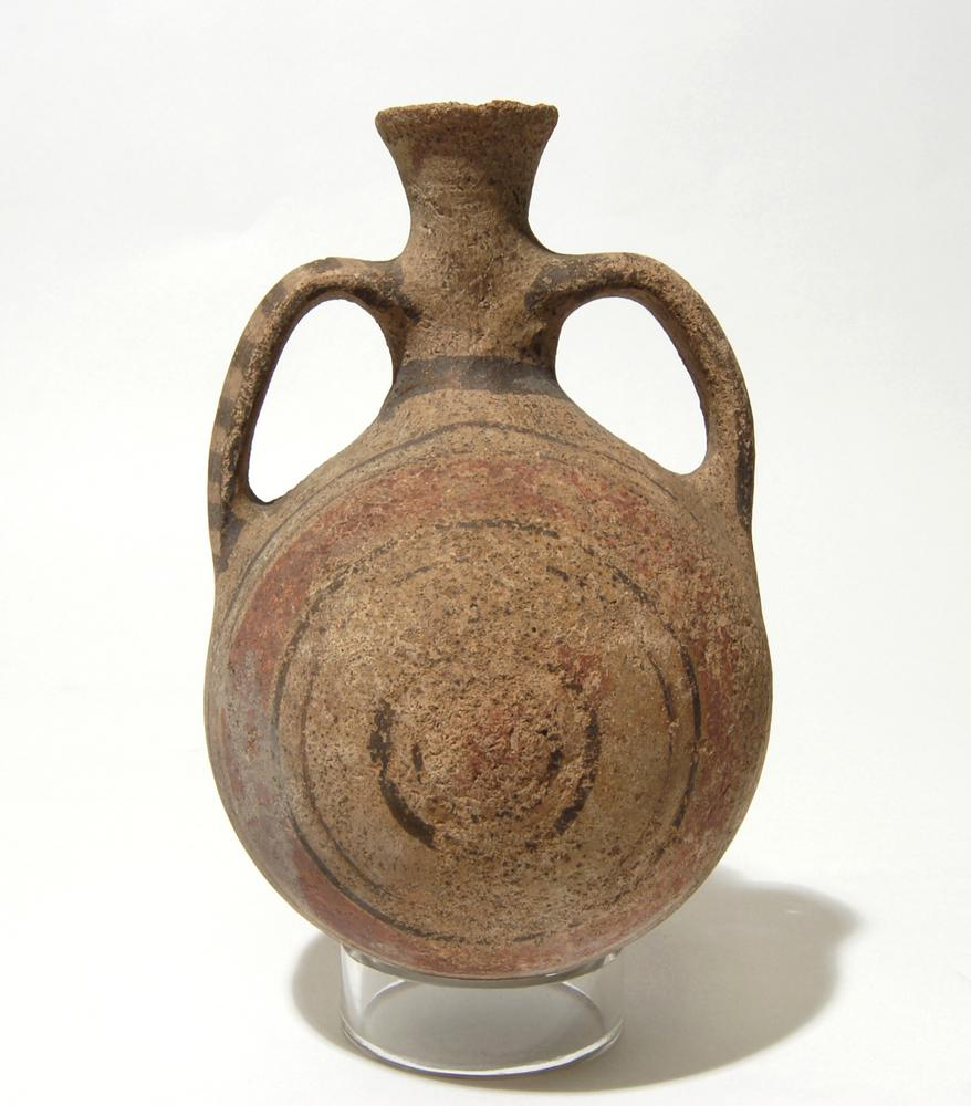 Pottery pilgrim flask in Bichrome I (?) ware; globular body; narrow neck flaring upwards, two vertical arching handles; red and black concentric decoration.