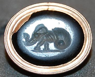 Nicolo gem engraved with an elephant emerging from a snail-shell.