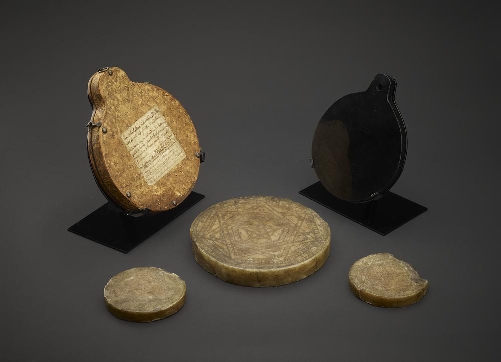 """Disc; wax; engraved with magical figures and names; used by Doctor Dee when consulting """"shew stones"""" or magic mirror; one of originally four piece set."""