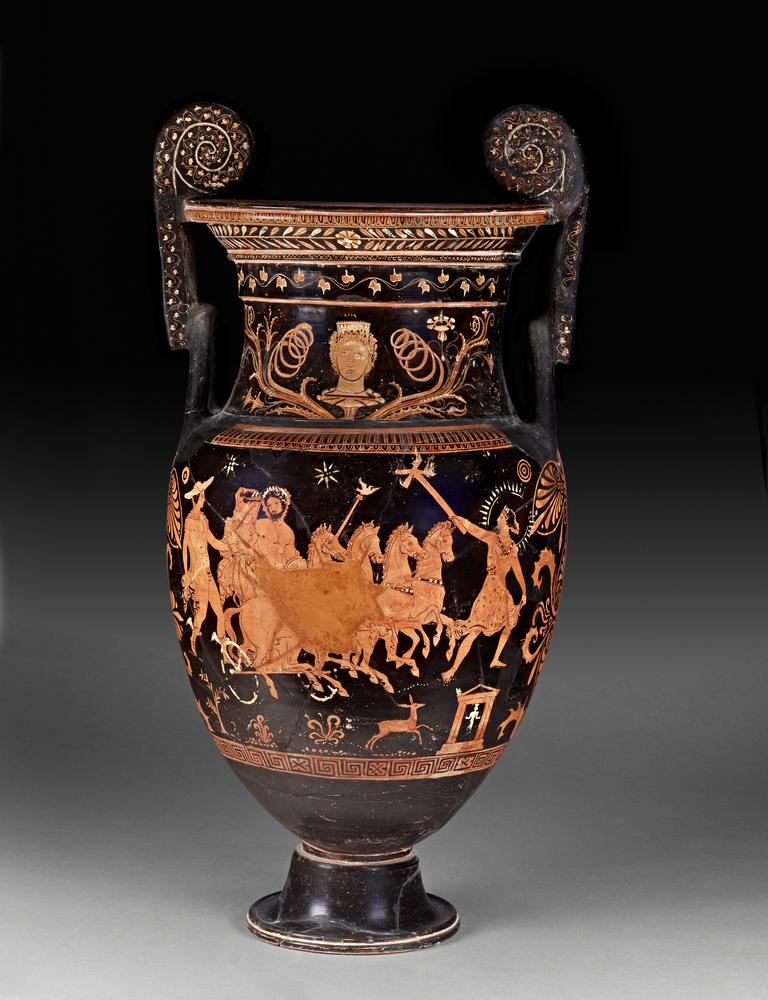 South Italian red figured pottery volute krater (bowl for mixing wine and water). Designs red on black ground, with accessories of white and yellow. On the lip, (a) above, egg-moulding; below, laurel-wreath with a rosette in the middle: (b) above, egg-moulding; below, rosettes. On the neck, (a) above the design, ivy-wreath: (b) palmettes and rosettes. Above each design, tongue- and egg-patterns; below the designs, maeander and crosses; below the handles, palmettes. On the handles in front are ivy-wreaths. On the neck, a head of Aura to the front, with curls and stephane ornamented with chevron  pattern, resting on the calyx of a flower from which luxuriant tendrils and blossoms branch out on either side; above, it is incised: AVDA, ???a. (a) Pluto carrying off Persephone: Pluto drives a chariot (turned partly to right) at full speed; he is bearded, with wreath, drapery over left arm, sceptre in left hand, with Ionic cap on which is a white eagle to right with wings spread. He turns to look at Persephone, who is at his right side, holding the frame of the chariot with left hand; her hair is gathered in a knot behind, and she wears a radiated ampyx, earrings, necklace, bracelets, long girt chiton, and embroidered himation drawn over her head as a veil with right hand. The horses have ornamented collars. On the left by the side of Persephone runs Hermes to right on slightly higher ground; he is beardless, with curly hair, petasos, bordered chlamys fastened with a fibula in front, winged endromides laced up in front, caduceus in right hand, left extended. On the right in advance of the chariot is Hecate, looking back and holding out in right hand a torch with four arms at the top, each having a flame; her hair is gathered in a bunch behind, and she wears radiated sphendone ornamented with maeander, necklace, bracelets, short embroidered chiton with girdle and cross-belt on which are white studs; behind her head is a radiated circle, partly restored. Below these figures the ground-lines are indicated by white dots. Below Hecate is a small heroon in antis on two steps, with anthemia on the pediment, in which is visible an archaic statue of a goddess to the front, with polos, painted white. On the left of it is a hind springing to right; also three plants and a shrub; ground-line of white dots. In the field above are two eight-point stars, a rosette, and two phialae (?). (b) Centauromachia: On the left is a Lapith fallen back on one knee, looking up to right at a Centaur rearing to left, who holds aloft in both hands a rock which he is about to hurl upon him. The Lapith has curly hair, bordered chlamys, sheath at side, sword drawn in right hand, and in left holds up his shield to protect himself; beneath him is his crested helmet and a spear. The Centaur has a panther's skin floating behind; a broken spear sticks in his left side. In the centre is a Lapith to the front (bordered chlamys fastened with a fibula in front), about to slay with club brandished in right hand a Centaur who has fallen on his hind-legs to right and turns back with arms extended in supplication; he wears a skin tied in front. On the right is a Centaur on a higher level to right, with skin tied in front and floating behind, charging on a Lapith, on whom he is about to hurl part of a tree held in both hands over his head. The Lapith moves to right, looking up to left, with right foot raised on a rock; he has curly hair, a crested helmet, shield, and spear pointed at each end, with which he has pierced the Centaur's right arm; below him is a peaked cap. All the Lapiths are beardless. Ground-lines of white dots, with stones; above, three phialae.
