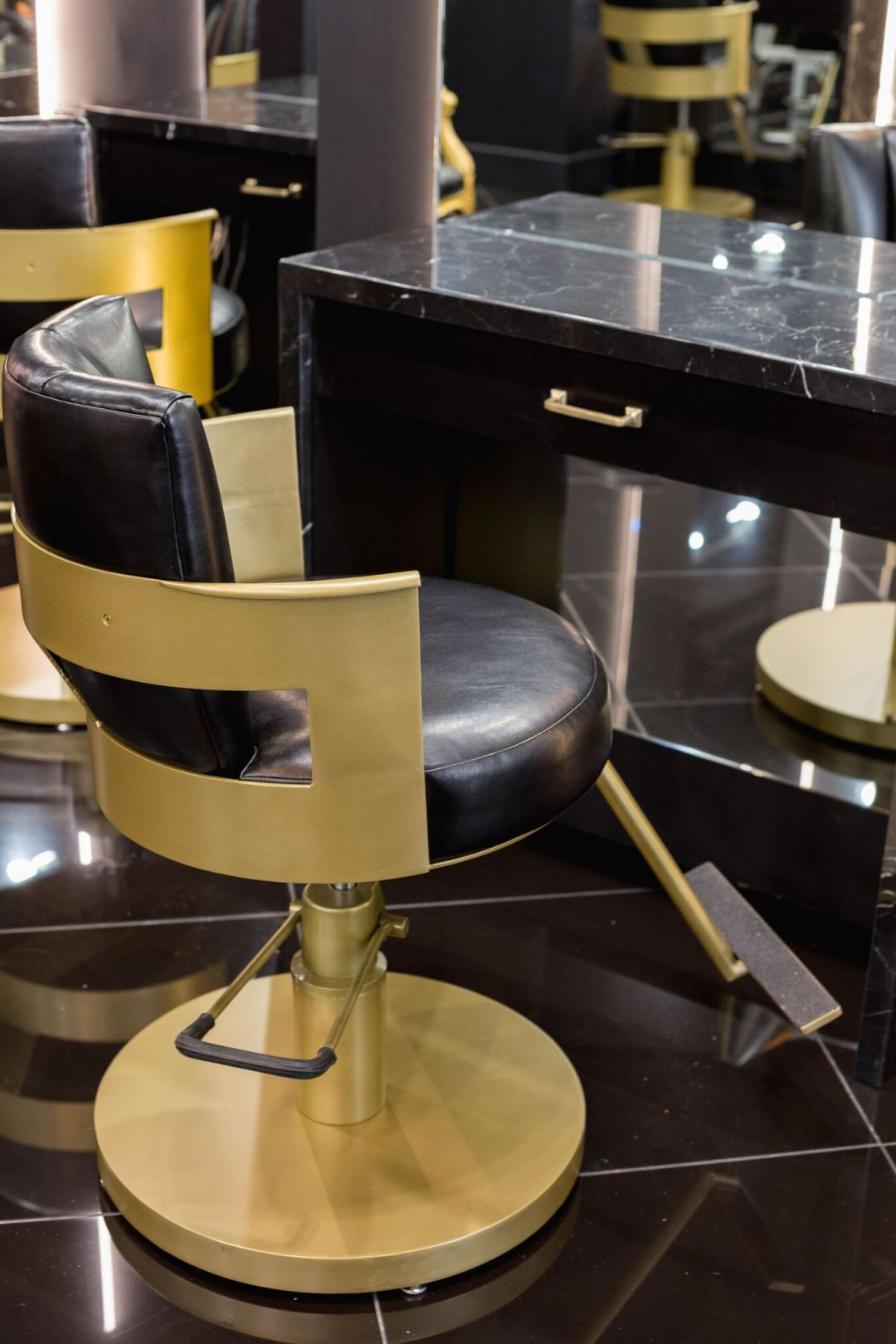 BE gold and black bar stool