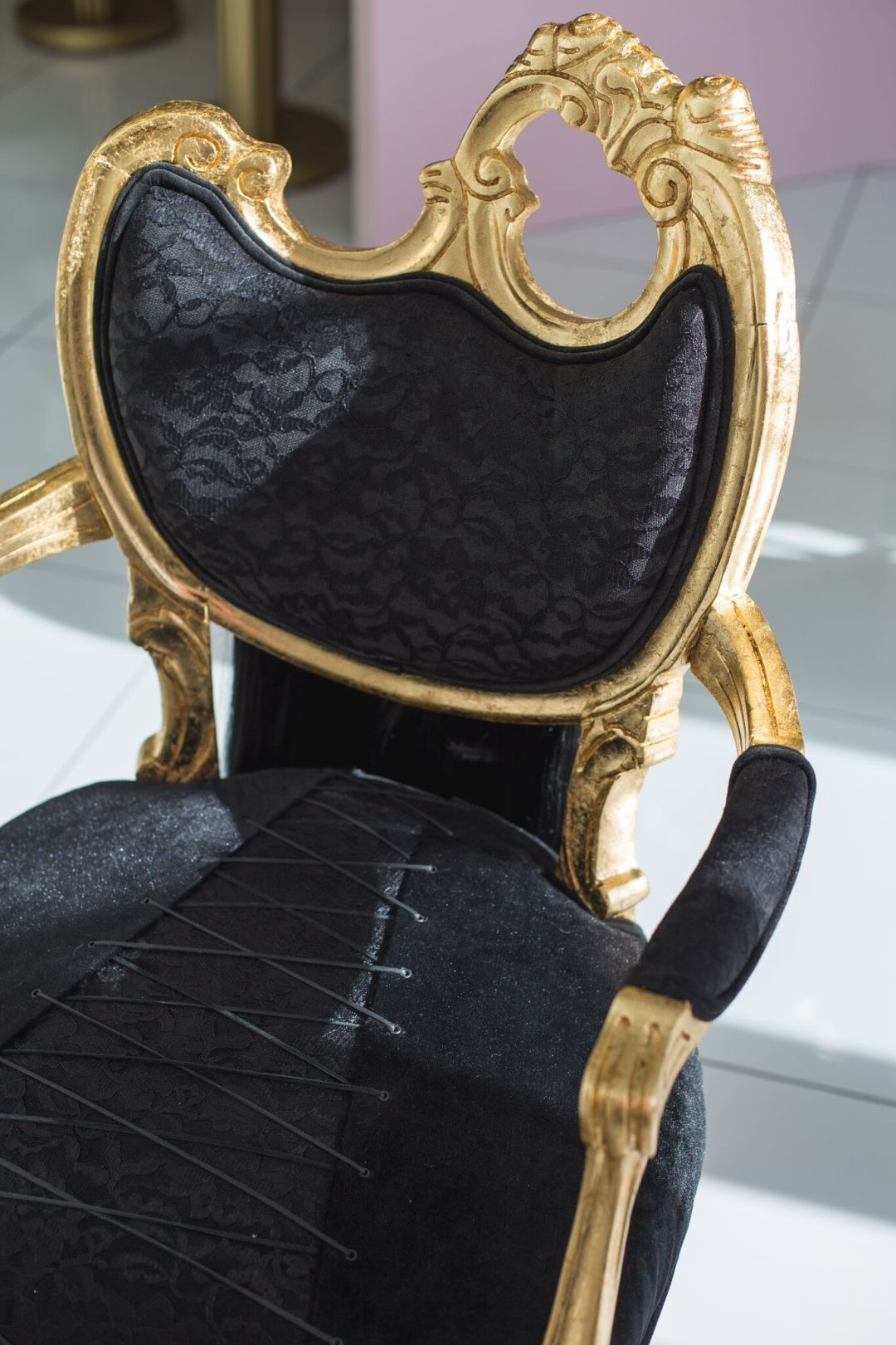close up vintage black and gold chair