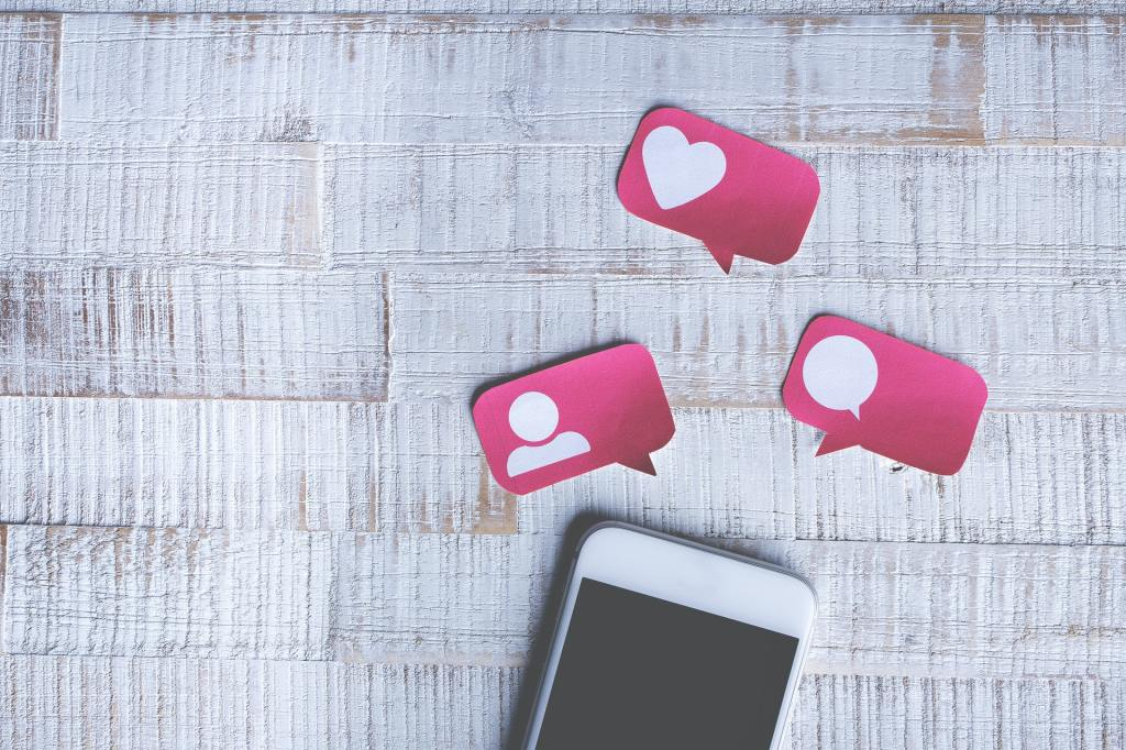 Phone with friend requests, comments and likes post it notes