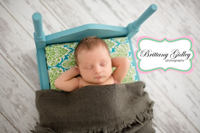 Newborn Baby Boy | Gray Blue Green Brown |Bed Pose | Sleepy Baby | Brittany Gidley Photography LLC