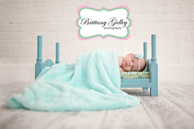 Newborn Baby Girl | Bed Pose | Baby Bed  Brittany Gidley Photography LLC