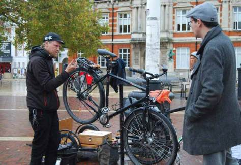 Brixton Cycles Jim Sullivan carrying out a bike repair