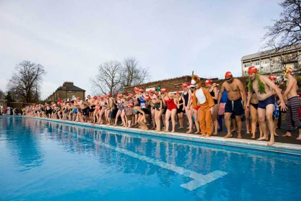 Swimmers at Brockwell Lido in support of Crisis