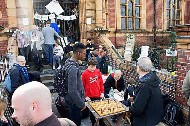 Members of Carnegie's free weekly chess club played outside on the steps