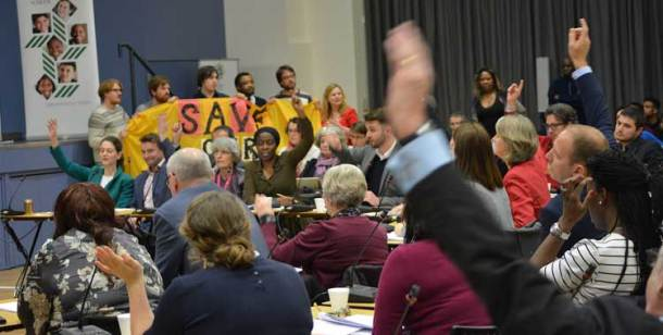 Protesters look on as councillors vote for the libraries plan at a council meeting earlier this year
