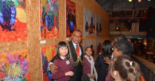Members of Hill Mead's Fine Art Club with Lambeth mayor Donates Anyanwu at their exhibition in Pop Brixton earlier this tear