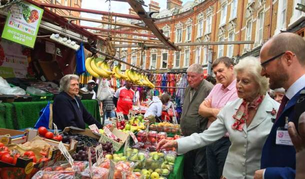 Princess Alexandra with market traders' CEO Stuart Horwood and Jonathan Pauling, chief executive of the Alexandra Rose charity meet stallholders