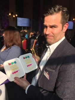 Rob Delaney with two awards
