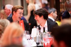 Black Mirror: Bandersnatch stars Will Poulter and Fionn Whitehead share a laugh.