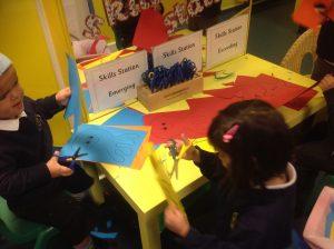 Using cutting skills to create sea creatures.