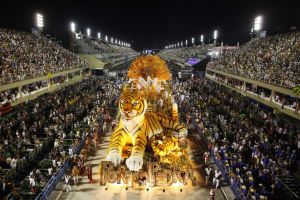 Dancers of Porto da Pedra samba school parade on a float during carnival celebrations at the Sambadrome in Rio de Janeiro, Brazil, Monday Feb.  20, 2012. (AP Photo/Felipe Dana)