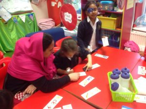 Working with the children to complete cvc and cvc words.