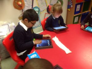 Using the iPads to practise spelling.