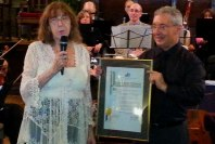 Board member Nancy Dunetz presents Mike with the framed proclamation.