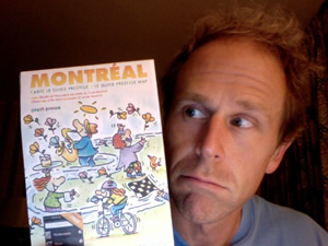 Photo of me holding a map of Montreal