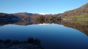 A still Rydal Water reflects the sky