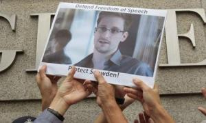 31472_4_wikileaks_founder_hails_nsa_whistleblower_edward_snowden_a_hero_declares_that_the_his_revelations_will_continue
