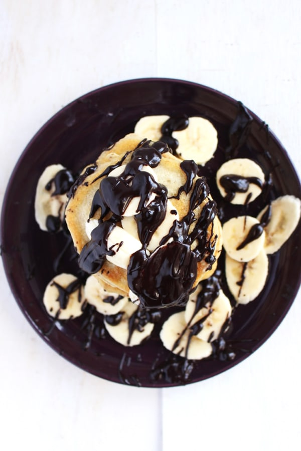 Vegan Banana Pancakes |Forget about your old greasy unhealthy pancakes and enjoy these guilt free, refined sugar-free vegan banana pancakes. Topped with a dark chocolate ganache that'll keep you coming back for more | BrokeFoodies.com