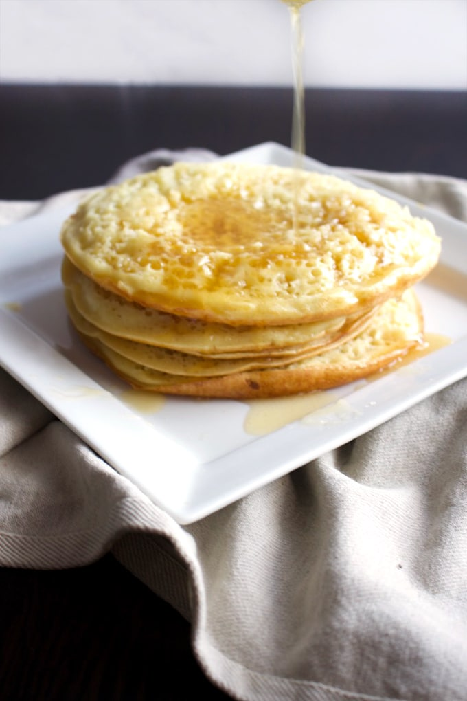 Moroccan Pancakes – Baghrir is a Moroccan breakfast pancake, made with semolina and topped with melted butter and honey! Sweet, easy and delicious, this Moroccan treat will keep you coming for more.