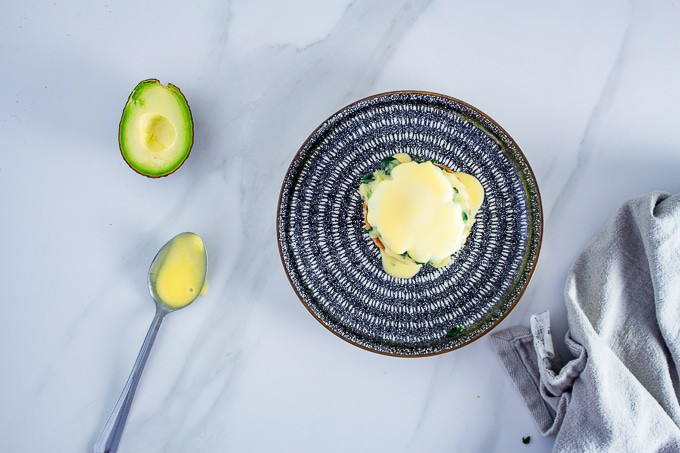 Keto Eggs Benedict - If you are looking for the Ideal Keto Breakfast Recipe, this is it. These eggs benedict are served with a creamy scoop of avocado and kale and served with a generous dollop of hollandaise sauce.