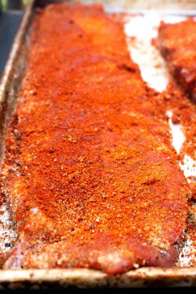 Uncooked ribs covered in sugar-free dry rub